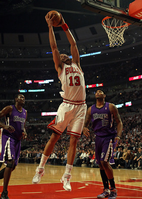 CHICAGO, IL - MARCH 21: Joakim Noah #13 of the Chicago Bulls grabs a rebound over Samuel Dalembert #10 (L) and DeMarcus Cousins #15 of the Sacramento Kings at the United Center on March 21, 2011 in Chicago, Illinois. NOTE TO USER: User expressly acknowled