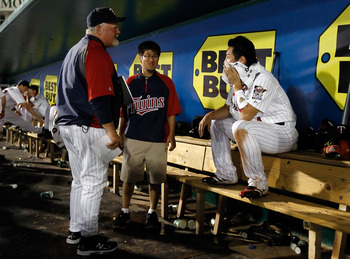 FORT MYERS, FL - FEBRUARY 27:  Manager Ron Gardenhire #35 talks with infielder Tsuyoshi Nishioka #1 of the Minnesota Twins after making a great play against the Boston Red Sox during a Grapefruit League Spring Training Game at Hammond Stadium on February