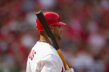 ST. LOUIS, MO - APRIL 3: Albert Pujols #5 of the St. Louis Cardinals waits on deck to bat against the San Diego Padre at Busch Stadium on April 3, 2011 in St. Louis, Missouri.  (Photo by Dilip Vishwanat/Getty Images)