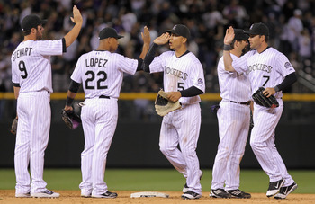 DENVER, CO - APRIL 02:  The Colorado Rockies celebrate their victory over the Arizona Diamondbacks at Coors Field on April 2, 2011 in Denver, Colorado. The Rockies defeated the Diamondbacks 3-1.  (Photo by Doug Pensinger/Getty Images)