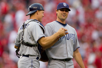 ST. LOUIS, MO - APRIL 2: Nick Hundley #4 and Pat Neshek #34 both of the San Diego Padres congratulate each other after beating the St. Louis Cardinals at Busch Stadium on April 2, 2011 in St. Louis, Missouri.  (Photo by Dilip Vishwanat/Getty Images)