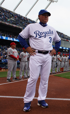 KANSAS CITY, MO - MARCH 31:  Manager Ned Yost #3 of the Kansas City Royals watches during player introductions prior to the start of the opening day game against the Los Angeles Angels of Anaheim at Kauffman Stadium on March 31, 2011 in Kansas City, Misso
