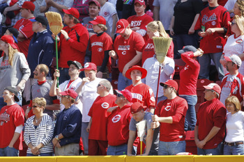 CINCINNATI, OH - APRIL 3: Cincinnati Reds fans hold up brooms late in the game against the Milwaukee Brewers at Great American Ball Park on April 3, 2011 in Cincinnati, Ohio. The Reds won 12-3 to finish off a three-game sweep. (Photo by Joe Robbins/Getty