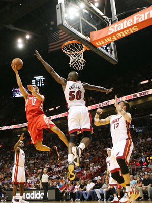 MIAMI, FL - MARCH 27:  Forward Mike Miller #13 (R) and Joel Anthony #50 of the Miami Heat defend  against gurad Kevin Martin #12 of the Houston Rockets  at American Airlines Arena on March 27, 2011 in Miami, Florida. NOTE TO USER: User expressly acknowled