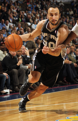 DENVER, CO - MARCH 23:  Manu Ginobili #20 of the San Antonio Spurs drives to the basket against the Denver Nuggets at the Pepsi Center on March 23, 2011 in Denver, Colorado. The Nuggets defeated the Spurs 115-112. NOTE TO USER: User expressly acknowledges