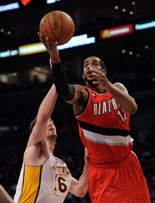LOS ANGELES, CA - MARCH 20:  LaMarcus Aldridge #12 of the Portland Trail Blazers goes in for a layup in front of Pau Gasol #16 of the Los Angeles Lakers at the Staples Center on March 20, 2011 in Los Angeles, California.  NOTE TO USER: User expressly ackn