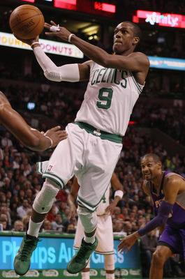 BOSTON, MA - MARCH 02:  Rajon Rondo #9 of the Boston Celtics heads for the basket as Grant Hill #33 of the Phoenix Suns defends on March 2, 2011 at the TD Garden in Boston, Massachusetts.  NOTE TO USER: User expressly acknowledges and agrees that, by down
