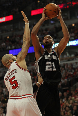 CHICAGO, IL - FEBRUARY 17: Tim Duncan #21 of the San Antonio Spurs puts up a shot over Carlos Boozer #5 of the Chicago Bulls at the United Center on February 17, 2011 in Chicago, Illinois. The Bulls defeated the Spurs 109-99. NOTE TO USER: User expressly