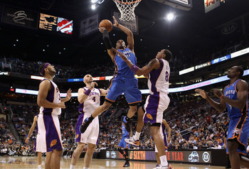 PHOENIX, AZ - MARCH 30:  Russell Westbrook #0 of the Oklahoma City Thunder puts up a shot over Channing Frye #8 of the Phoenix Suns during the NBA game at US Airways Center on March 30, 2011 in Phoenix, Arizona.  NOTE TO USER: User expressly acknowledges