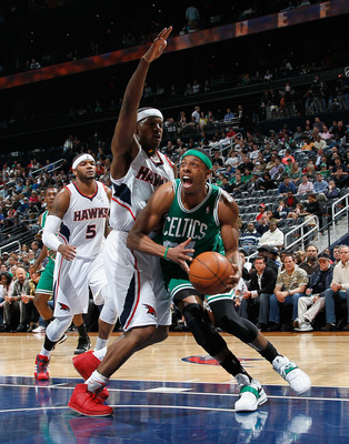 ATLANTA, GA - APRIL 01:  Paul Pierce #34 of the Boston Celtics drives to the basket against Joe Johnson #2 of the Atlanta Hawks at Philips Arena on April 1, 2011 in Atlanta, Georgia.  NOTE TO USER: User expressly acknowledges and agrees that, by downloadi
