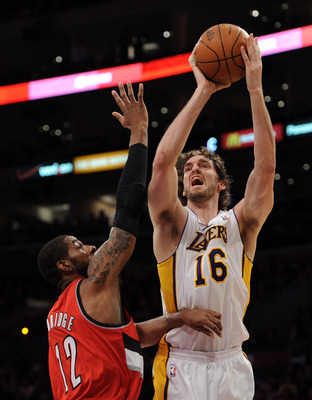 LOS ANGELES, CA - MARCH 20:  Pau Gasol #16 of the Los Angeles Lakers shoots a jumper in front of LaMarcus Aldridge #12 of the Portland Trail Blazers at the Staples Center on March 20, 2011 in Los Angeles, California.  NOTE TO USER: User expressly acknowle