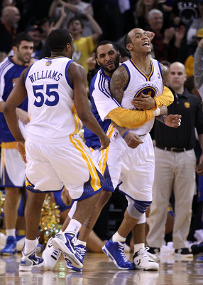 OAKLAND, CA - JANUARY 19:  Monta Ellis #8 of the Golden State Warriors is congratulated by teammates after he made the winning shot with 0.6 seconds left in their game againsts the Indiana Pacers at Oracle Arena on January 19, 2011 in Oakland, California.