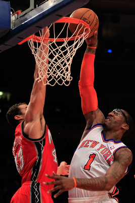 NEW YORK, NY - MARCH 30:  Amar'e Stoudemire #1 of the New York Knicks shoots over Kris Humphries #43 of the New Jersey Nets at Madison Square Garden on March 30, 2011 in New York City. NOTE TO USER: User expressly acknowledges and agrees that, by download