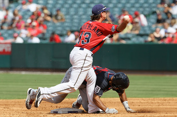 ANAHEIM, CA - JULY 11:  U.S. Futures All-Star Drew Cumberland #13 of the San Diego Padres looks to turn a double play as World Futures All-Star Wilkin Ramirez #33 of the Detroit Tigers is out at second base during the 2010 XM All-Star Futures Game at Ange