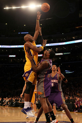 LOS ANGELES, CA - MAY 27:  Lamar Odom #7 of the Los Angeles Lakers takes a shot as Amar'e Stoudemire #1 of the Phoenix Suns defends in the second quarter of Game Five of the Western Conference Finals during the 2010 NBA Playoffs at Staples Center on May 2