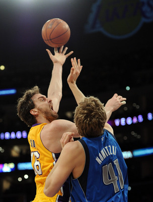 LOS ANGELES, CA - MARCH 31:  Pau Gasol #16 of the Los Angeles Lakers shoots a jump hook over Dirk Nowitzki #41 of the Dallas Mavericks at Staples Center on March 31, 2011 in Los Angeles, California.  NOTE TO USER: User expressly acknowledges and agrees th