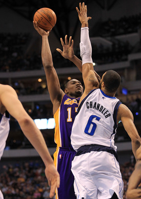 DALLAS, TX - MARCH 12:  Center Andrew Bynum #17 of the Los Angeles Lakers takes a shot against Tyson Chandler #6 of the Dallas Mavericks at American Airlines Center on March 12, 2011 in Dallas, Texas.  NOTE TO USER: User expressly acknowledges and agrees