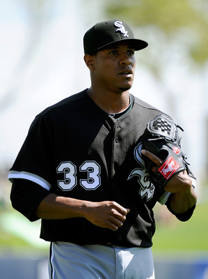 PHOENIX, AZ - MARCH 17:  Pitcher Edwin Jackson #33 of the Chicago White Sox warms up in the bullpen before playing the Milwaukee Brewers during the spring training game at Maryvale Baseball Park on March 17, 2011 in Phoenix, Arizona.  (Photo by Kevork Dja