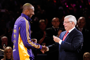 LOS ANGELES, CA - OCTOBER 27:  Kobe Bryant #24 of the Los Angeles Lakers receives his championship ring from NBA Commissioner David Stern before the season opening game against the Los Angeles Clippers at Staples Center on October 27, 2009 in Los Angeles,
