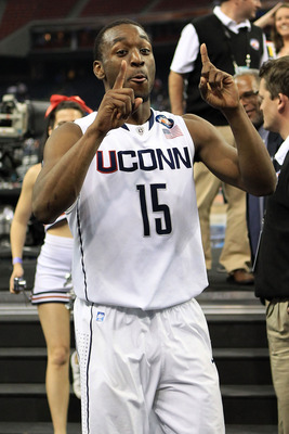 HOUSTON, TX - APRIL 02:  Kemba Walker #15 of the Connecticut Huskies celebrates after defeating the Kentucky Wildcats during the National Semifinal game of the 2011 NCAA Division I Men's Basketball Championship at Reliant Stadium on April 2, 2011 in Houst