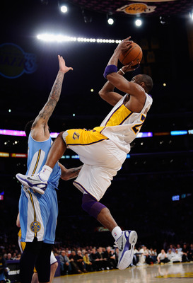 LOS ANGELES, CA - APRIL 03:  Kobe Bryant #24 of the Los Angeles Lakers shoots a basket over Wilson Chandler #21 during the NBA basketball game at Staples Center on April 3, 2011 in Los Angeles, California. NOTE TO USER: User expressly acknowledges and agr