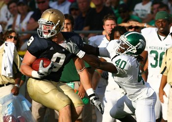 SOUTH BEND, IN - SETPEMBER 19: Kyle Rudolph #9 of the Notre Dame Fighting Irish pulls away from Roderick Jenrette #40 of the Michigan State Spartans on September 19, 2009 at Notre Dame Stadium in South Bend, Indiana. Notre Dame defeated Michigan State 33-