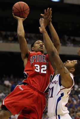 SAN ANTONIO, TX - MARCH 25:  Justin Harper #32 of the Richmond Spiders puts up a shot against Markieff Morris #21 of the Kansas Jayhawks during the southwest regional of the 2011 NCAA men's basketball tournament at the Alamodome on March 25, 2011 in San A