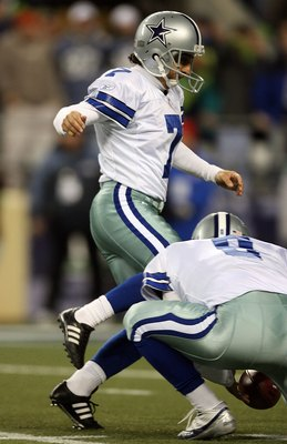 SEATTLE - JANUARY 06:  Martin Gramatica #7 of the Dallas Cowboys attempts a field goal in the fourth quarter of the NFC Wild Card Playoff Game against the Seattle Seahawks on January 6, 2007 at Qwest Field in Seattle, Washington. Tony Romo #9 picks up his