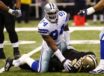 NEW ORLEANS - DECEMBER 19:  Linebacker DeMarcus Ware #94 of the Dallas Cowboys sacks quarterback Drew Brees #9 of the New Orleans Saints at the Louisiana Superdome on December 19, 2009 in New Orleans, Louisiana. (Photo by Scott Halleran/Getty Images)