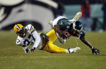 PHILADELPHIA - JANUARY 11:  Wide receiver Freddie Mitchell #84 of the Philadelphia Eagles catches a first down pass on defensive back Michael Hawthorne #27 of the Green Bay Packers on the Eagles last posession in the forth quarter during the NFC divisiona