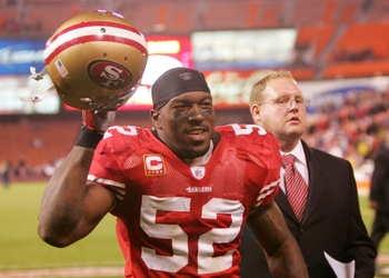 SAN FRANCISCO - DECEMBER 14:  Linebacker Patrick Willis #52 of the San Francisco 49ers runs off the field after defeating the Arizona Cardinals at Candlestick Park on December 14, 2009 in San Francisco, California. (Photo by Ezra Shaw/Getty Images)