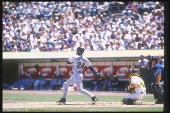 15 Jul 1997: Center fielder Ken Griffey Jr. of the Seattle Mariners swings at the ball during a game against the Oakland Athletics at the Oakland Coliseum in Oakland, California. The Athletics won the game 8-5.