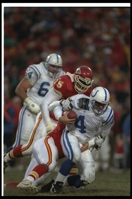 15 Dec 1996: Quarterback Jim Harbaugh of the Indianapolis Colts gets tackled by a Kansas City Chiefs player during a game at Arrowhead Stadium in Kansas City, Missouri. The Colts won the game, 24-19.