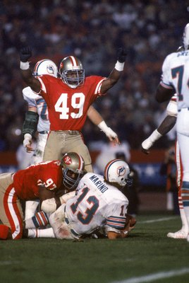 STANFORD, CA - JANUARY 20:  Linebacker Jeff Fuller #49 of the San Francisco 49ers celebrates after teaming up with teammate Gary Johnson #97 on a sack against Miami Dolphins quarterback Dan Marino #13 during Super Bowl XIX at Stanford Stadium on January 2