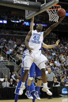 NEWARK, NJ - MARCH 27:  Harrison Barnes #40 of the North Carolina Tar Heels in action against Josh Harrellson #55 of the Kentucky Wildcats during the east regional final of the 2011 NCAA men's basketball tournament at Prudential Center on March 27, 2011 i