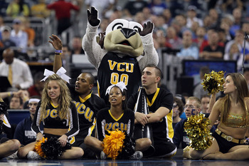 HOUSTON, TX - APRIL 02:  The Virginia Commonwealth Rams mascot and cheer team on the baseline as the Rams take on the Butler Bulldogs during the National Semifinal game of the 2011 NCAA Division I Men's Basketball Championship at Reliant Stadium on April