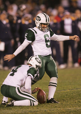 SAN DIEGO - JANUARY 08:  Kicker Doug Brien #6 of the New York Jets kicks the game winning field goal in overtime against the San Diego Chargers during the AFC wild-card game at Qualcomm Stadium on January 8, 2005 in San Diego, California.   The Jets defea