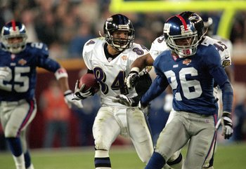 28 Jan 2001:  Jermaine Lewis #84 of the Baltimore Ravens runs with the ball for a run back touchdown during the Super Bowl XXXV Game against the New York Giants at the Raymond James Stadium in Tampa, Florida. The Ravens defeated the Giants 34-7. Mandatory