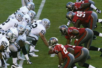 SAN DIEGO - JANUARY 26:  Center Adam Treu #62 of the Oakland Raiders (starting for Barret Robbins) readies to hike the ball as the offense lines up against the Tampa Bay Buccaneers defense during Super Bowl XXXVII on January 26, 2003 at Qualcomm Stadium i
