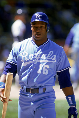 1990:  Bo Jackson #16 of the Kansas City Royals walks on the field with his bat on hand during a game in the 1990 season.  (Photo by Jonathan Daniel/Getty Images)