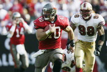 TAMPA, FL - JANUARY 12:  Mike Alstott #40 of the Tampa Bay Buccaneers runs the ball against the San Francisco 49ers during the NFC Divisional Playoff game at Raymond James Stadium on January 12, 2002 in Tampa, Florida. The Buccaneers defeated the 49ers 31