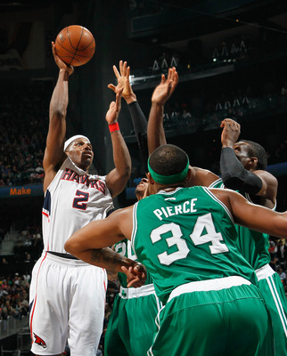 ATLANTA, GA - APRIL 01:  Joe Johnson #2 of the Atlanta Hawks shoots over Paul Pierce and the Boston Celtics at Philips Arena on April 1, 2011 in Atlanta, Georgia.  NOTE TO USER: User expressly acknowledges and agrees that, by downloading and/or using this