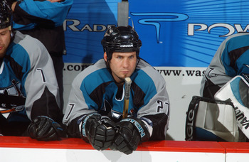 WASHINGTON - NOVEMBER 19:  Defenseman Bryan Marchment #27 of the San Jose Sharks looks on from the bench against the Washington Capitals during the NHL game at the MCI Center on November 19, 2002 in Washington D.C.  The Sharks won 3-2.  (Photo By Mitchell