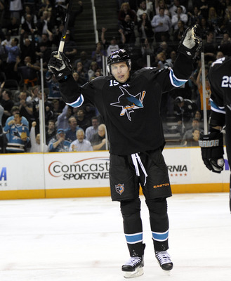 SAN JOSE, CA - MARCH 31: Dany Heatley #15 of the San Jose Sharks celebrates after teammate Logan Couture scores a goal against the Dallas Stars in the second period during an NHL hockey game at the HP Pavilion on March 31, 2011 in San Jose, California. (P