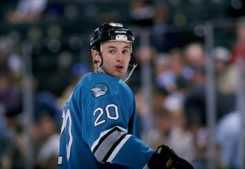 28 Mar 1998:  Defenseman Andrei Zyuzin of the San Jose Sharks in action during a game against the Dallas Stars at Reunion Arena in Dallas, Texas. The Sharks defeated the Stars 4-1. Mandatory Credit: Stephen Dunn  /Allsport