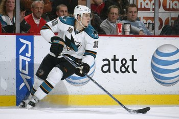 DETROIT - FEBRUARY 29:  Matt Carle #18 of the San Jose Sharks skates with the puck against the Detroit Red Wings during their NHL game at Joe Louis Arena on February 29, 2008 in Detroit, Michigan. (Photo by Dave Sandford/Getty Images)