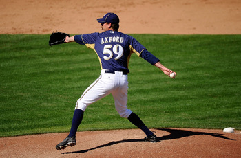 PHOENIX, AZ - MARCH 10:  John Axford #59 of the Milwaukee Brewers pitches against the Colorado Rockies during spring training baseball game at Maryvale Baseball Park on March 10, 2011 in Phoenix, Arizona.  (Photo by Kevork Djansezian/Getty Images)