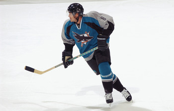 WASHINGTON, D.C. - NOVEMBER 19:  Right wing Teemu Selanne #8 of the San Jose Sharks skates against the Washington Capitals during the NHL game at the MCI Center on November 19, 2002 in Washington D.C.  The Sharks won 3-2.  (Photo by Doug Pensinger/Getty I