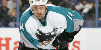 ST. LOUIS, MISSOURI - MARCH 21: Jonathan Cheechoo #14 of the San Jose Sharks waits on the ice during the game against the St. Louis Blues on March 21,2006 at the Savvis Center in St. Louis, Missouri. The San Jose Sharks defeated the St. Louis Blues 6-0(Ph