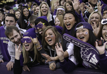 SEATTLE - NOVEMBER 28:  Washington Huskies fans cheer during the game against the Washington State Cougars on November 28, 2009 at Husky Stadium in Seattle, Washington. The Huskies defeated the Cougars 30-0. (Photo by Otto Greule Jr/Getty Images)